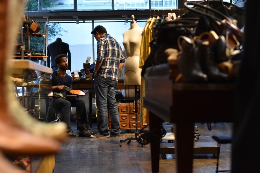 Stylist Nick Brentley (left) goes over customization options of tailored shoes with customer Dylan Nguyen (right) at Al's Attire in San Francisco, Calif., on Monday, Feb. 12, 2018.