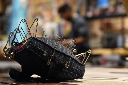 A tailor's pincushion awaits further use as Al's Attire designer Nick Brentley selects fabric styles nearby in San Francisco, Calif., on Tuesday, Feb. 13, 2018.