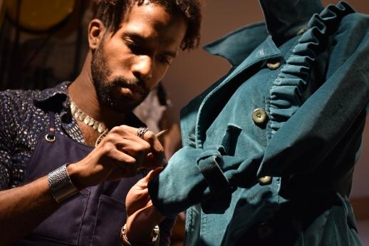 Stylist Nick Brentley sews up a stray thread on a display coat at Al's Attire in San Francisco, Calif., on Tuesday, Feb. 13, 2018.