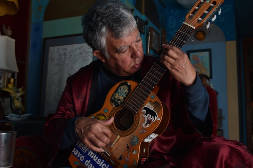 Musician and artist Jerry Ferraz plays the guitar at his home in San Francisco, Calif., on Saturday, April 7, 2018. (Boone Ashworth)