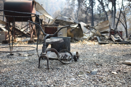 The remains of a tricycle stand near a burned out house in French Gulch, California. (Boone Ashworth/Xpress)