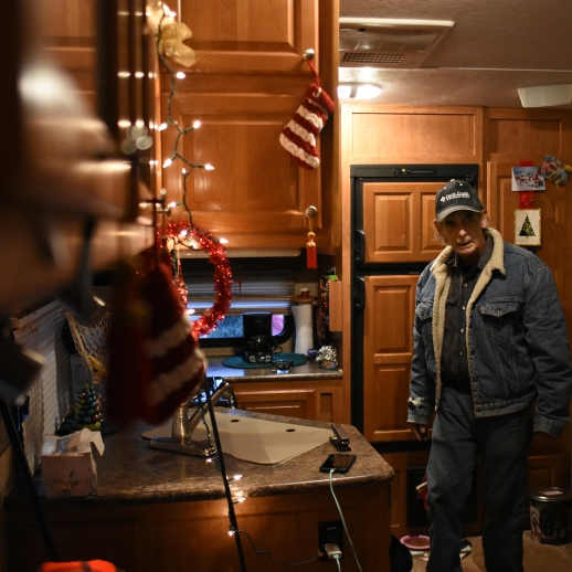 Doug Major stands in the trailer he shares with his girlfriend Jeanette Hernandez in Keswick, California, on December 24, 2018. (Photo by Boone Ashworth)