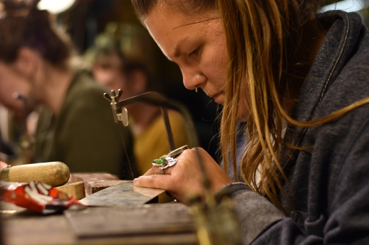 Lauren Rios, a student of Metalworks SF, cuts a sheet of metal down to size on Thursday, Nov. 30, 2017 in San Francisco, Calif.