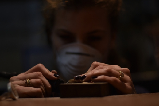 Adriana Bolotsky grinds down the edges of her wooden ring mold at Metalworks SF school of jewelry making in San Francisco, Calif. on Thursday, Nov. 30, 2017.