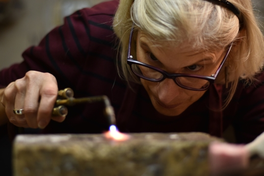Metalworks SF student Lisa Martin uses an oxyacetylene welding torch to melt down steel into a pliable form on Thursday, Nov. 30, 2017.