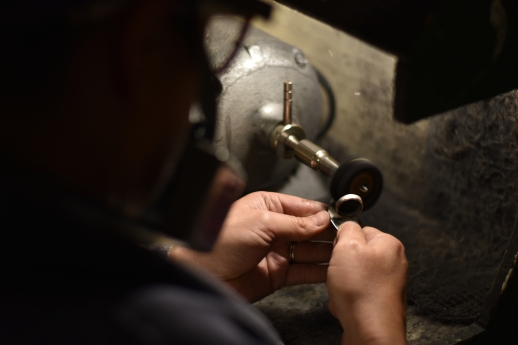 Lauren Rios polishes the ring she made at Metalworks SF in San Francisco, Calif. on Thursday, Nov. 30, 2017.