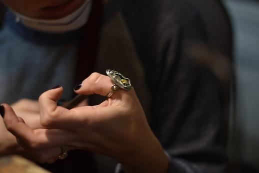 Adriana Bolotsky admires a ring made by Julia Farrow at Macchiarini Creative Design in San Francisco, Calif. on Thursday, Nov. 30, 2017.