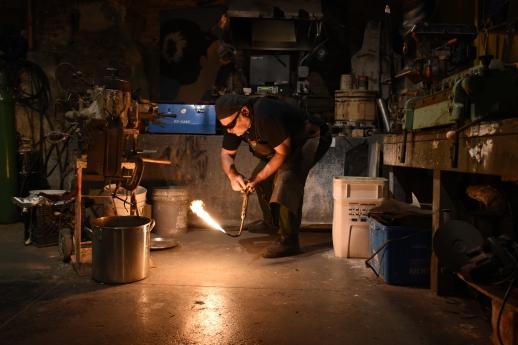 Daniel Macchiarini, owner of jewelry shop Macchiarini Creative Design, shuts off his torch as he finishes casting a silver ring at his shop in San Francisco.