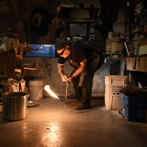 Daniel Macchiarini, owner of jewelry shop Macchiarini Creative Design, shuts off his torch as he finishes casting a silver ring at his shop in San Francisco.